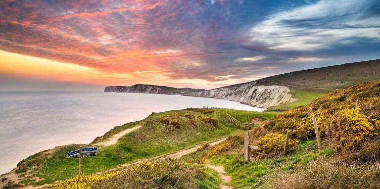 Sunset over compton bay cliffs and sea